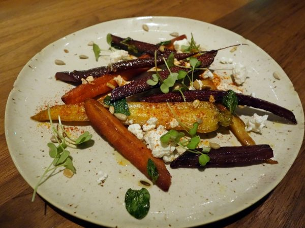 Honey-roasted carrots, fennel seeds, feta, sunflower seeds, and smoked paprika