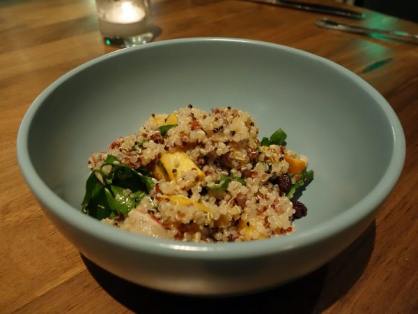 Fall quinoa tabouleh, butternut squash, currants, baby arugula, mint, and lemon