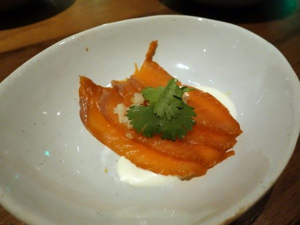 Soy sauce-cured Alaskan King salmon, Asian pear, creme fraiche, and cilantro