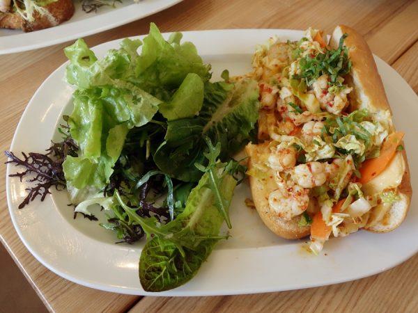 Warm rock shrimp roll with Napa cabbage slaw, basil, mint, citrus aioli, smoke and chili at Marlowe