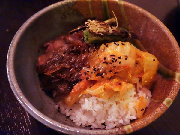 """Kimchi gyudon"" with cabbage kimchi, seared hanger steak and charred leeks over steamed rice at Pink Zebra"