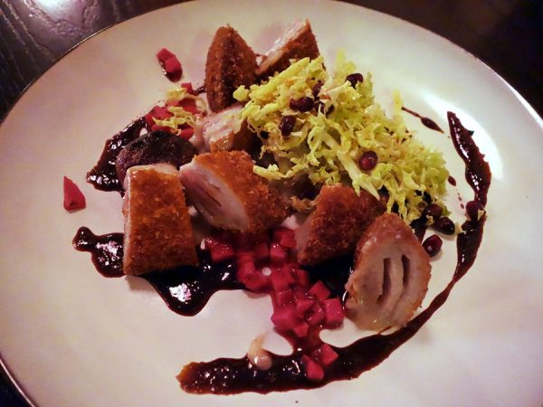 At Pink Zebra: menchi katsu with smoked tonkatsu sauce, gruyere, hot and cold cabbage, plum pickled ginger, onion agrodolce, and pomegranate seeds