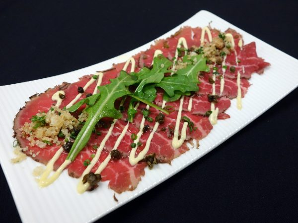 Smoked beef carpaccio with dijonnaise, fried capers, and chives at The View