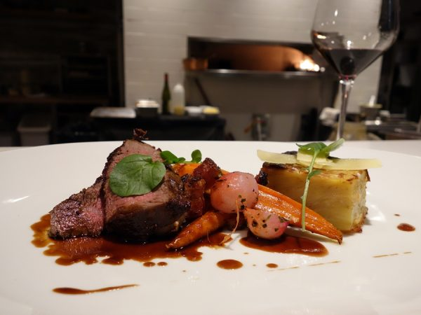 Double R Ranch filet with roasted local vegetables, potato gratin, and bordelaise sauce