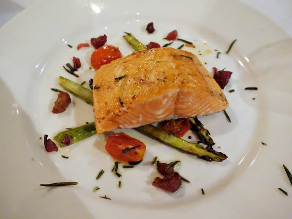Seared Alaskan king salmon with asparagus and tomato salad, pancetta lardons, fried rosemary, Bormane Rivera Italian evoo, and 25-year Oro di Reggio Emilia balsamic vinegar (served with pecorino polenta)