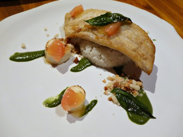 Cane & Canoe's kona kampachi with aromatic rice, hearts of palm, fresh green curry, and grapefruit-yuzu gel