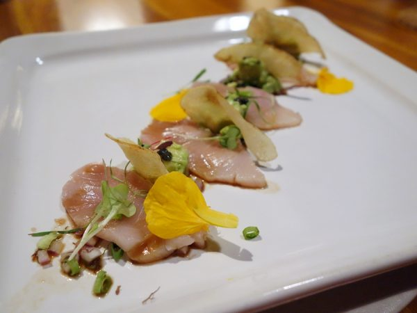 Hamachi poke with caviar, avocado, and fingerling potato chips at Cane & Canoe