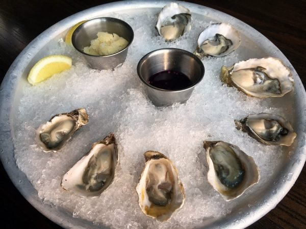 Oysters with peppercorn ice and red wine mignonette