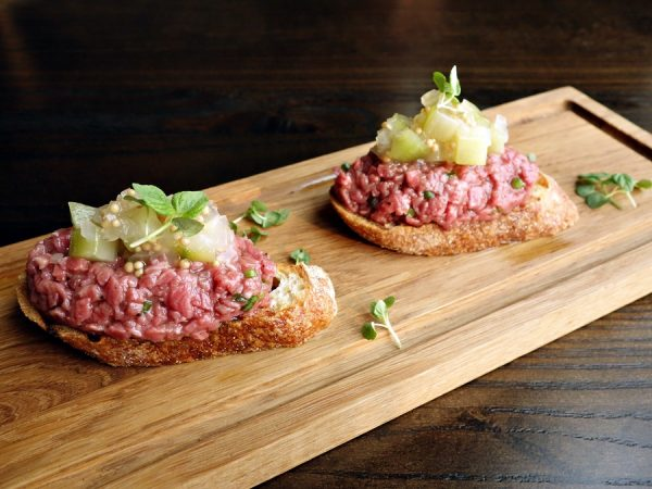 Beef tartare with 12-year scotch and cucumber relish on grilled bread