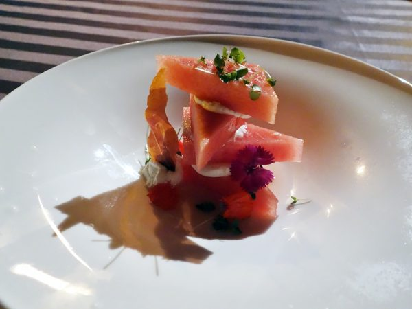Really enjoyed this Surfing Goat Dairy cheese and watermelon with prosciutto crackling, red wine & rose gastrique, and edible blossoms at Humuhumunukunukuapua'a