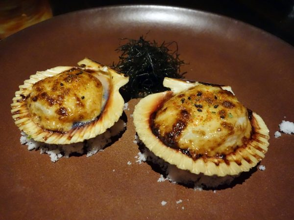 Baked scallops on the half shell with tobiko mayo, shichimi sea salt, and ogo seaweed at Japengo