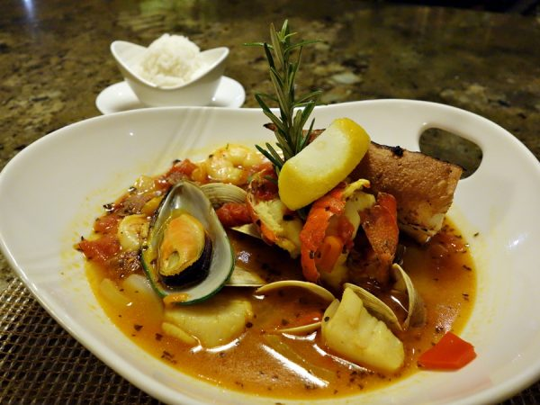 Ko's zarzuela: a kettle of lobster, shrimp, scallops, mussels, clams, and chorizo simmered in rich saffron broth