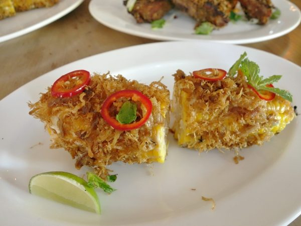 Grilled corn on the cob rolled in Maggi mayo, lime leaf, and pork floss, topped with pickled chilis and mint - moves me closer to being a fan of pork floss (like meaty cotton candy)