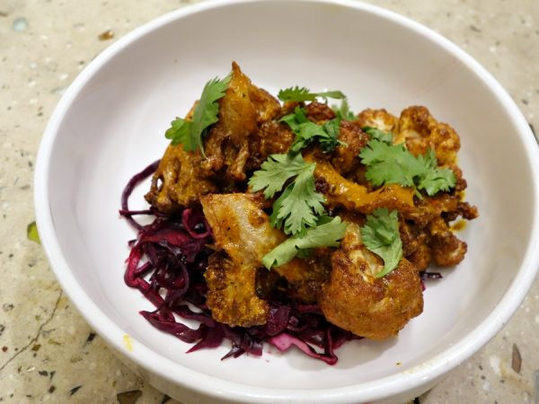 Cauliflower vindaloo with red onion, lemon, and cilantro.