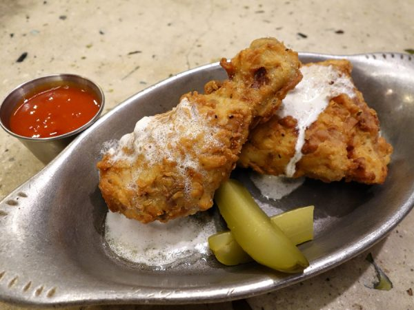 """Some of the best fried chicken I've ever had. This is a sampling of the """"Bucket of Barrel-Aged TABASCO Fried Chicken"""" that comes with cultured butter and lacto-fermented pickles."""