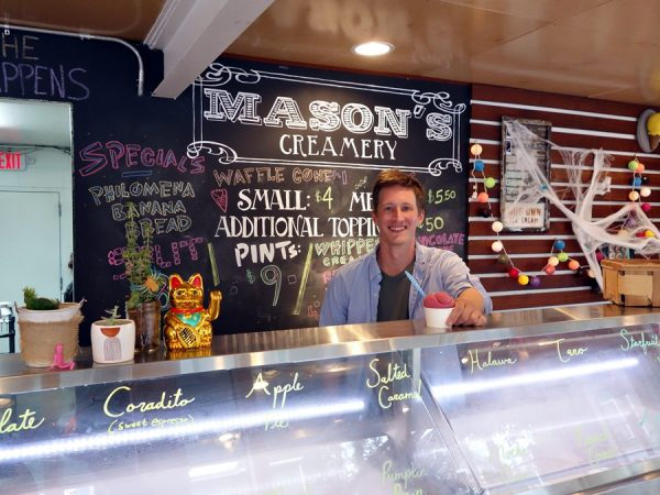 Jesse Mason of Mason's Creamery, serving me a concord grape sorbet after sampling many ice creams.