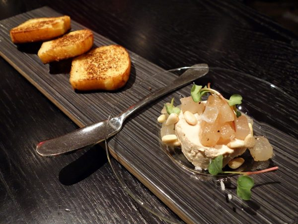 Tofu turned rich: tofu and foie gras parfait with compressed Korean pear-black pepper jam, pine nuts, and toasted brioche.