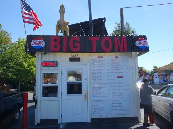 Cars on both sides of the Eastside Big Tom shack