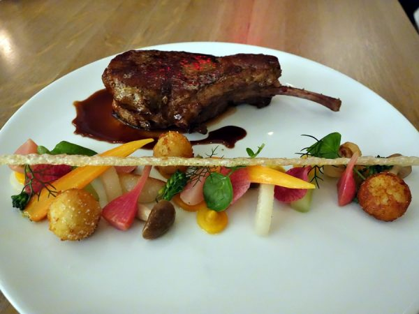 Snake River Farm berkshire pork chop, pommes dauphine, glazed seasonal vegetables, sherry-scented pork jus, chicharrones (beautiful presentation)