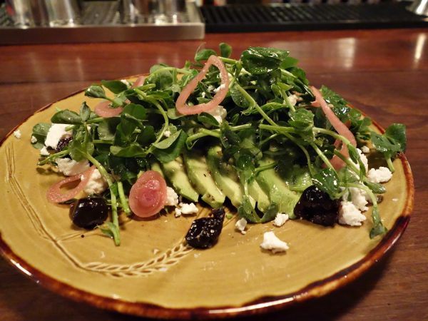 Avocado salad with pea vine shoots (substituting for the usual mustard greens), pickled red onion, feta, sun-dried olives, and za'atar at Espana