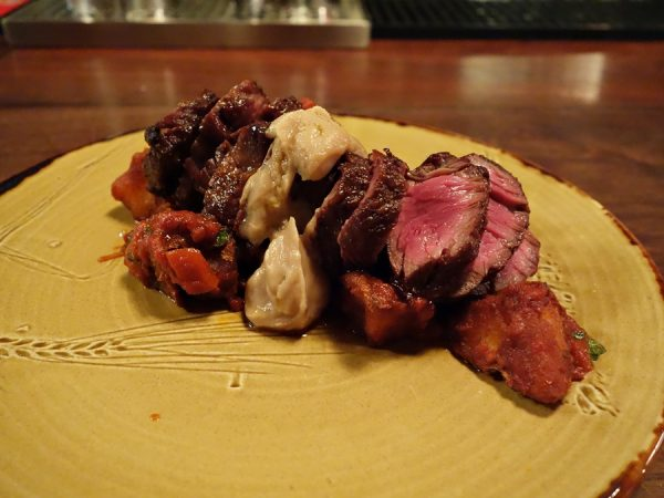 Espana's grilled hanger steak with patatas bravas, garlic & Pedro Ximenez cream