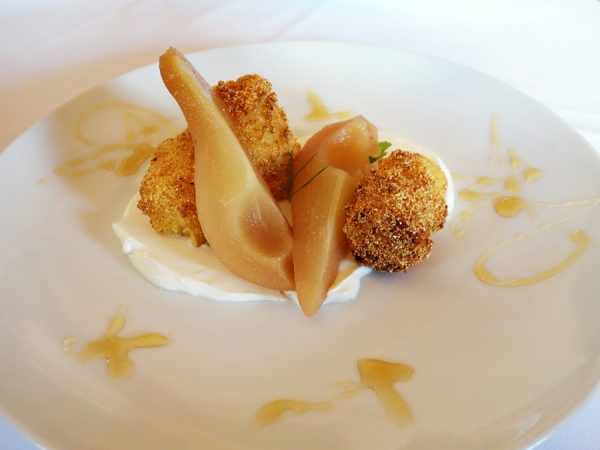 Sauternes-poached pear with fried cornmeal pudding, creme fraiche, and honey at Restaurant August. Amazing. Loved the texture of the cornmeal pudding!