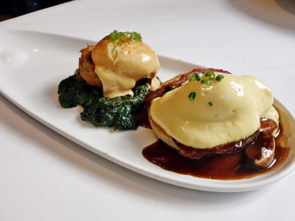 What do you do when you can't decide between Eggs Sardou (with crispy artichokes, Parmesan-creamed spinach, and choron sauce) and Eggs Hussarde (a Brennan's original, with housemade English muffin, coffee-cured Canadian bacon, hollandaise, and marchand de vin sauce)? Get one of each!