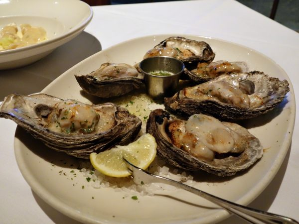 Smoked sizzling oysters (huge!) at GW Fins. A delightful treatment of delicious oysters. (And, yes, just a peek at lobster dumplings in the background.)