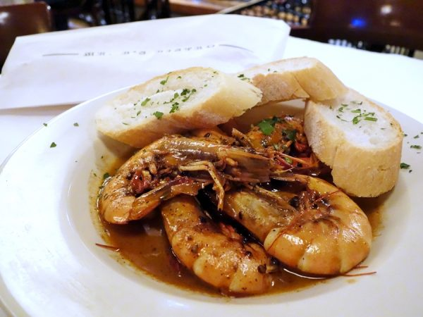 The incredible Mr. B's barbequed shrimp. With an extra bag of warm bread to sop up the delicious sauce!