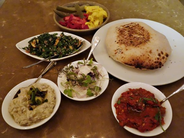An assortment of small plates to accompany the amazing pita at Shaya. Assorted pickles, tabouleh, baba ganoush, ikra (paddlefish caviar spread with shallots), and lutenitsa (Bulgarian puree of roasted pepper, eggplant, garlic and tomato).