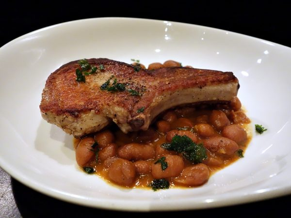 Pork chop with borlotti beans at Lincoln.