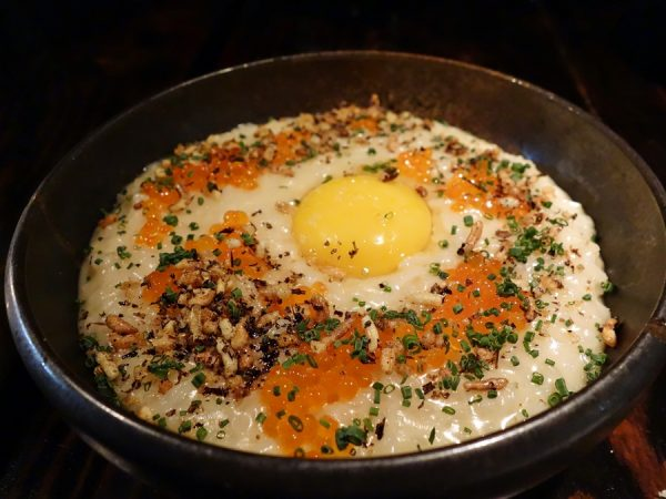 Favorite dish of the Muselet meal: (rice) porridge with warm yolk, trout roe, chive, puffed rice, butter and fish sauce.