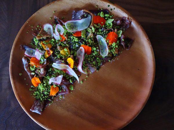 Dry-aged ribeye tartare with nasturtium, shaved radish, and sorrel vinaigrette at Vestal.