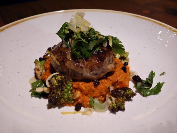 Anderson Ranch Oregon lamb crepinette with hazelnut-romesco, caramelized romanesco, and lemon-herb salad