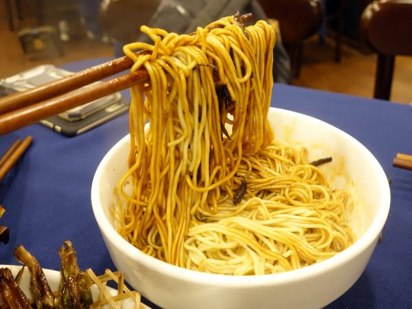 Noodles with green scallion oil. After mixing, requested even more oil!