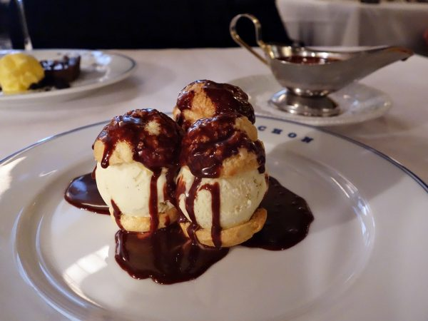 Profiteroles (chocolate tart with mandarin orange sorbet in background) at Bouchon