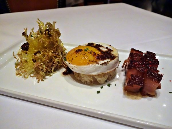 Duck egg with frisée and pork belly at Carnevino