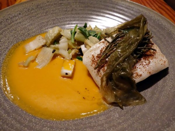 OLO's halibut with confit potatoes, cabbage, seaweed salad, and tomato prawn sauce