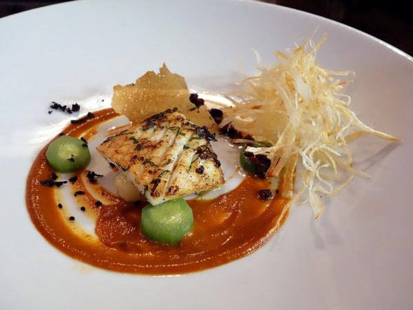 Saveur's squid with charred pepper coulis, potato ragout, compressed cucumber, and olive